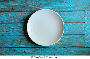 emoty plate on the cyan wood background