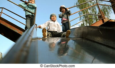 slide - Children going down slide
