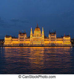 budapest parliament with light reflections - night shot of...