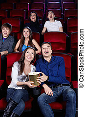 Laughing people - Young people in the cinema