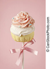 Colorful cupcake pops on pink