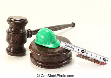 labor law - judges gavel with building-site helmet and...