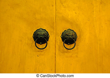 Chinese handle on yellow door