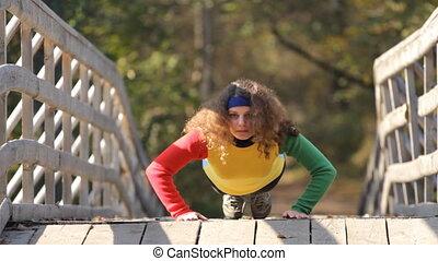 caucasian girl doing push ups