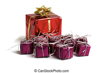 Small wrapped Christmas gifts on a white background