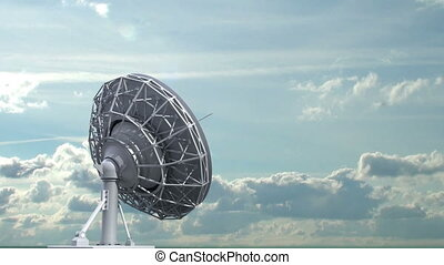 rotating radio telescope on sky background, 3d animation