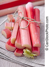 Rhubarb - Bunch of fresh rhubarb on wooden background