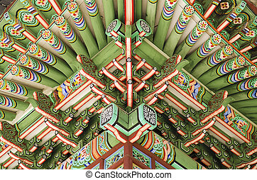 detail of wooden painted palace building seoul south korea