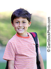 Elementary age schoolboy - Smiling young schoolboy with...