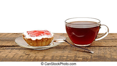 fresh cupcakes and a glass cup tea on wooden table