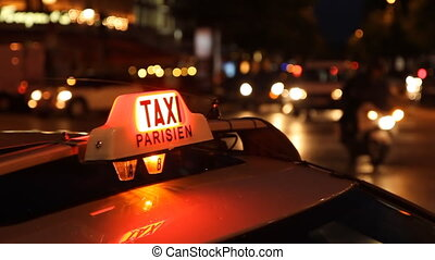 Taxi Parisien - Paris taxi at night on the Champs...