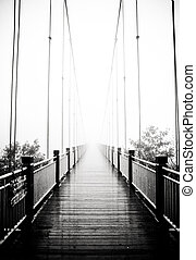pedestrian bridge - view on pedestrian wooden bridge in mist
