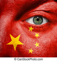 Flag painted on face with green eye to show China support