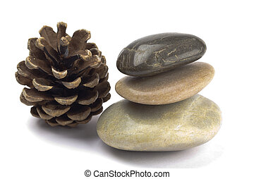 Pebbles - Shiny smooth pebbles in a stack with a pine cone