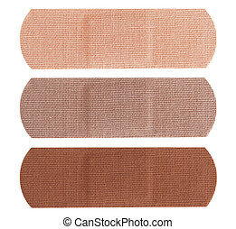 Bandages in different skin colors - Three bandages in...