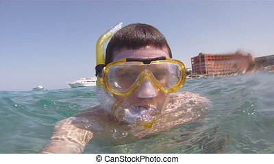 Man swims with a mask