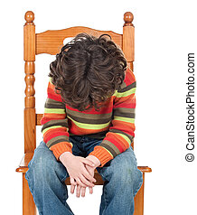 Sad child sitting on a chair isolated on a over white...