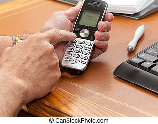 Man dialing from wireless phone - Caucasian man pressing...