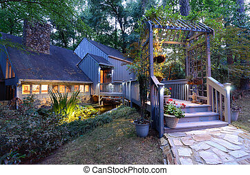 Home Entrance in the Woods - House exterior with porch...