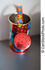 small watering pot - small colourfull watering pot on a...