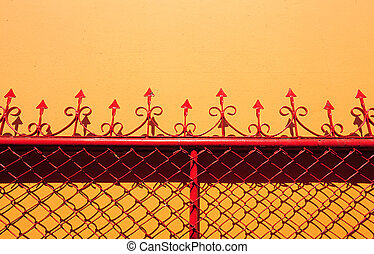 Red net metal steel on orange wall - Red net metal steel on...