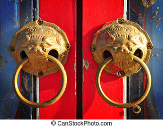 Red chinese dirty door with a lion dragon head