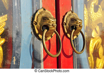 Red chinese dirty door with a lion head