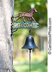 Welcome sign - Welcome sign with a ring bell