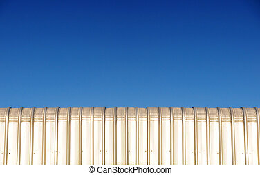 silver metal roof and blue sky background