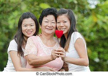 Happy Asian Senior lady and her daughters