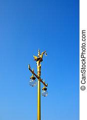 Thai style light bulb on the blue sky