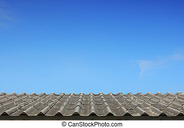Old roof on the blue sky