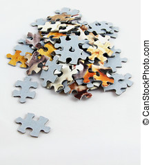 Jigsaw Pieces - A pile of jigsaw puzzle pieces