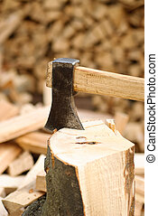 Firewood with axe, close up, shallow deep of field