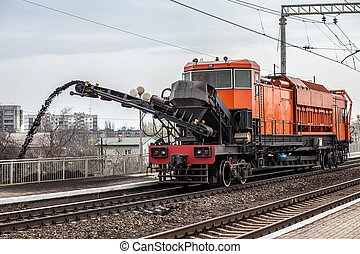 Repair of railway - Cleaning of the railroad tracks to...