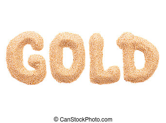 The word GOLD made out of sand