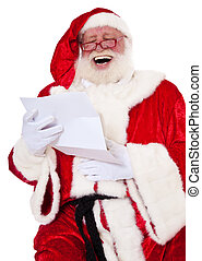 Santa Claus in authentic look having fun reading wish list...