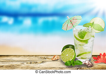 Summer drink - Fresh ice summer drink on beach background