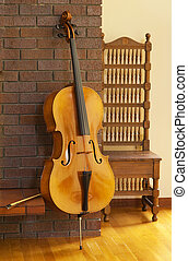 Cello or violoncello resting on fireplace