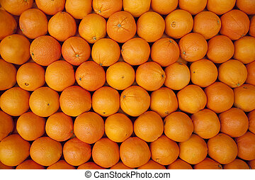 Oranges stacked in rows