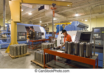 Machine shop worker quality testing steel tunes