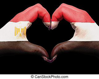 Tourist made gesture  by egypt flag colored hands showing symbol of heart and love