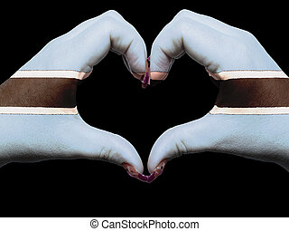 Tourist made gesture  by botswana flag colored hands showing symbol of heart and love