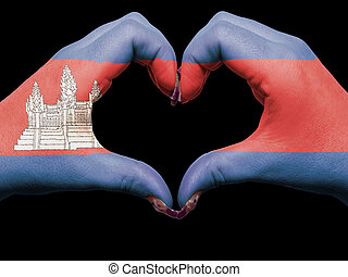 Tourist made gesture  by cambodia flag colored hands showing symbol of heart and love