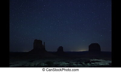 Monument Valley Starry Night - Time lapse Stars, planes and...
