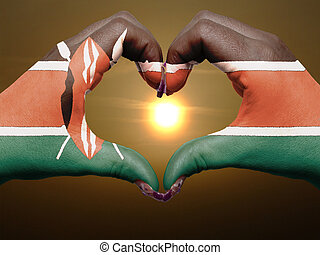 Tourist made gesture by kenya flag colored hands showing...