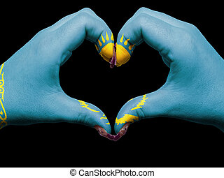Tourist made gesture  by kazakhstan flag colored hands showing symbol of heart and love