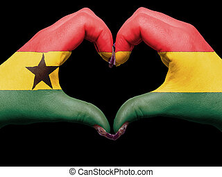 Tourist made gesture  by ghana flag colored hands showing symbol of heart and love