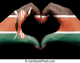Tourist made gesture  by kenya flag colored hands showing symbol of heart and love