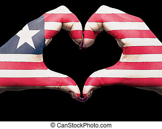 Tourist made gesture  by liberia flag colored hands showing symbol of heart and love